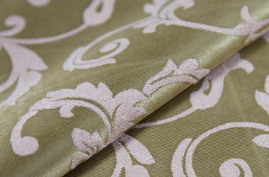 Ткань блэкаут с рисунком зеленого оттенка